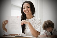 Girl with exam paper (thumbnail)