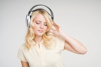 A young woman listening to music