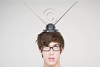 A teenage boy with an antenna on his head