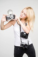 A young woman taking pictures
