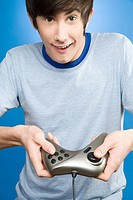 A teenage boy playing a video game