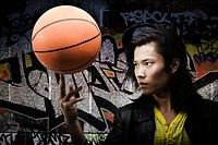 A young man balancing a basketball finger (thumbnail)