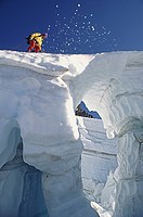 Climber crossing snow bridge on coleman glacier