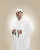 Portrait of a muslim man holding prayer beads