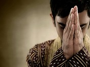 A hindu man praying