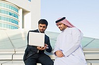 Businessmen using a laptop
