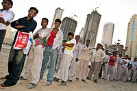 bengali workers working at the construction of the new dubai media city, dubai, united arab emirates