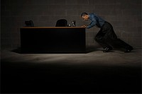 Man pushing desk