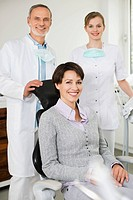 Woman at with dentist and hygienist
