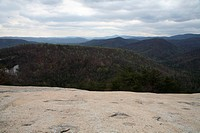 The granite covered top of Stone Mountain State Park in North Carolina. This image was taken in the spring. Stone mountain is an example of the expose...