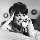 Sixteen_year_old girl, Michelle Tuttle, talking on the phone. Photographed in 1964.