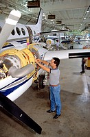 A man works on a plane at the Beechcraft Aircraft factory in Witchita, Kansas.