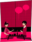 A couple having sushi together at a Japanese restaurant (thumbnail)