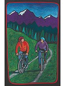 A couple biking along a trail with a forest and mountains behind them