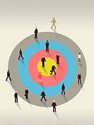 Business people walking on top of a bulls eye target