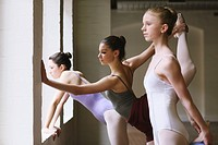 Teenager ballet dancers standing in a row
