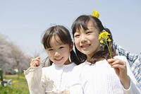 Two Japanese girls holding flowers