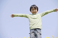 Japanese boy with arms outstretched