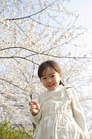 Japanese girl holding flower