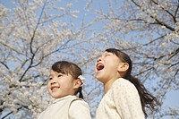 Two Japanese sisters smiling and laughing