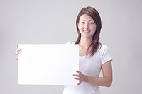 Smiling Japanese Woman with Whiteboard