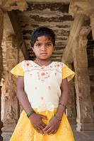 Girl standing in a temple, Hampi, Karnataka, India