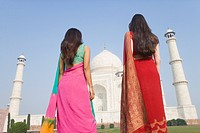 Two women standing in front of a mausoleum, Taj Mahal, Agra, Uttar Pradesh, India