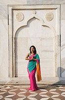 Woman greeting in front of a mausoleum, Taj Mahal, Agra, Uttar Pradesh, India