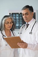 Female doctor discussing with a doctor, Gurgaon, Haryana, India