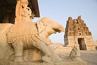 Stone Chariot with a temple in the background, Vitthala Temple, Hampi, Karnataka, India