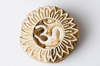 Om symbol engraved on wood