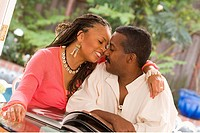 African couple kissing outdoors