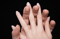 Young couple with fingers interlocked close_up of hands
