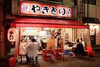 People sitting at a fast food at night, Yurakucho Yakitori Alley, Ginza, Tokyo, Japan