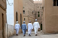 Men walking, Al Hamra, Oman
