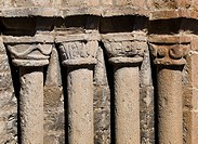 Columns and capitals on the main front of the Romanesque collegiate church of Santa Maria (12th century), Ainsa. Sobrarbe, Huesca province, Aragon, Sp...