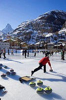 People curling on a rink, Matterhorn in background, Zermatt, Valais, Switzerland