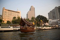 Ferry leaving pier, Hotel in background, Menam Chao Phraya River, Bangkok, Thailand