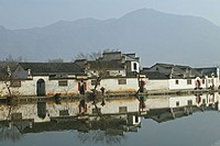 The pond reflecting the traditional houses of the village Hongcun, Huangshan, China, Asia