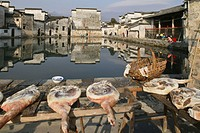 Sales stand with ham in front of pond at the village Hongcun, Huangshan, China, Asia