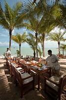 Waiters setting the table in a beach restaurant, Mae Nam Beach, Hat Mae Nam, Ko Samui, Thailand
