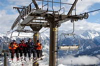 A group of skiers sitting on a chair lift, Bad Gastein, Austria