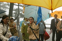 A group of pilgrims standing in the rain, Jiuhua Shan, Anhui province, China, Asia