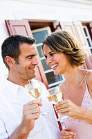 Man and woman drinking white wine out of doors