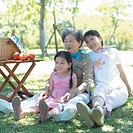 Three generation family, having picnic
