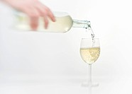 White wine being poured into a wine glass