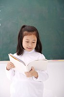 Girl reading to class, front view