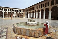 Rear view of a woman standing near a fountain in a mosque, Umayyad Mosque, Ancient City of Damascus (UNESCO World Heritage Site, 1979), Syria