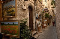 France - Provence-Alpes-Côte d'Azur Region - Saint-Paul-de-Vence. Exhibition of paintings along a lane