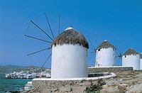 Three traditional windmills at the waterfront, Kato Myli, Mykonos, Cyclades Islands, Greece